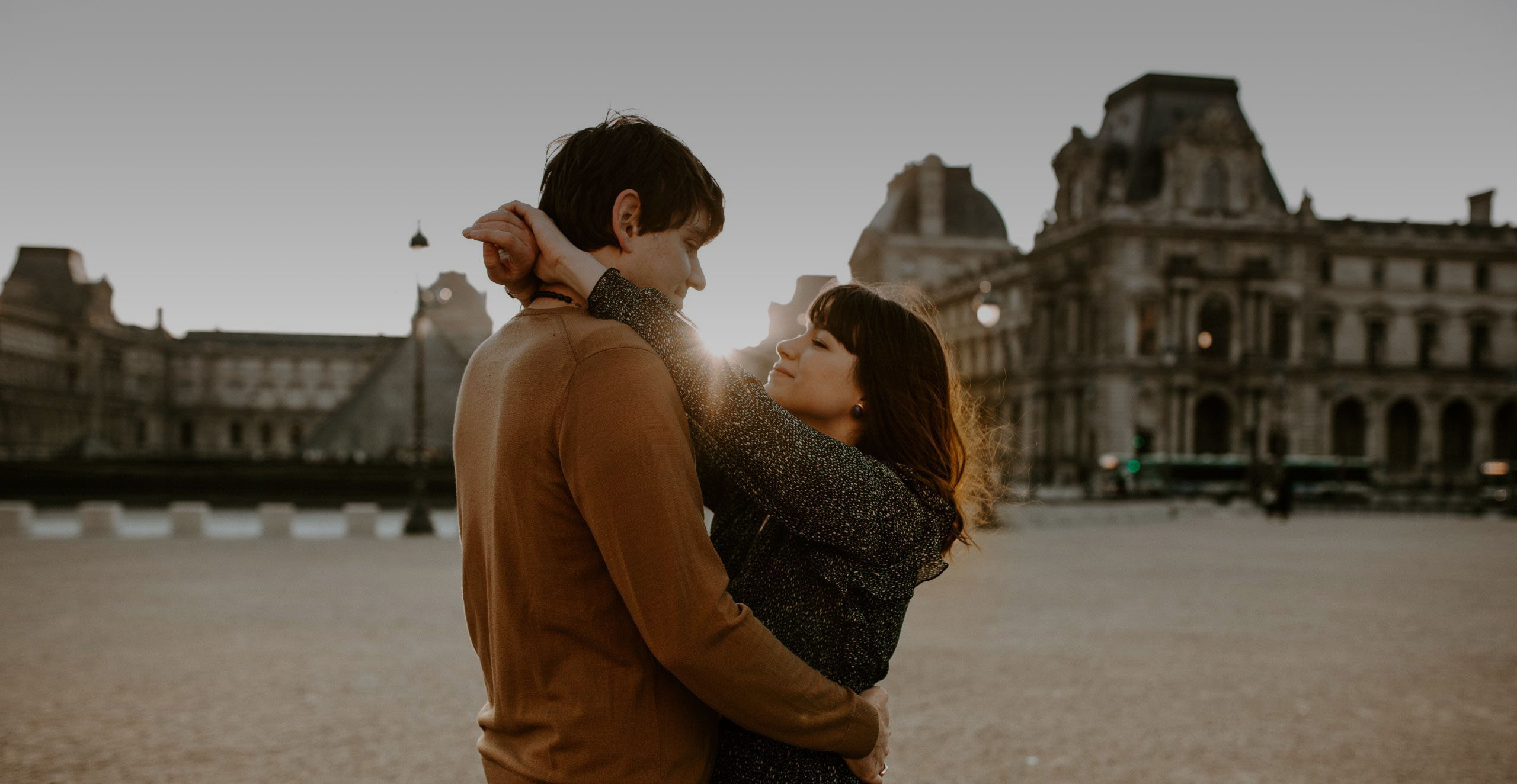 A photo of Alison and Lance near the Louvre in Paris